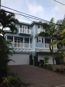 exterior of a blue duplex that was painted by Silveria Painting