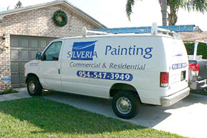 a Silveria Painting van parked in front of a house.